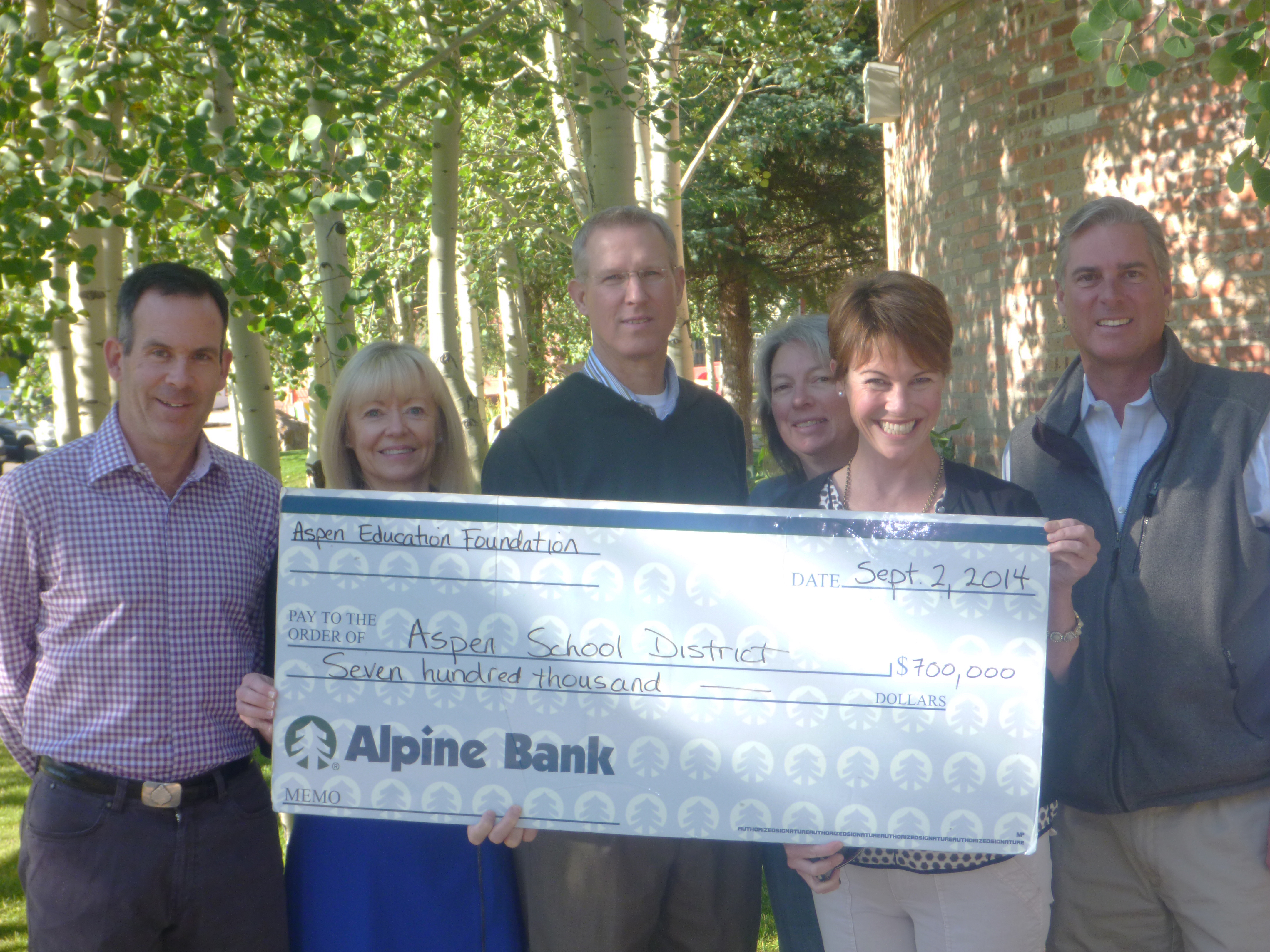 AEF presents check to ASD for $700,000